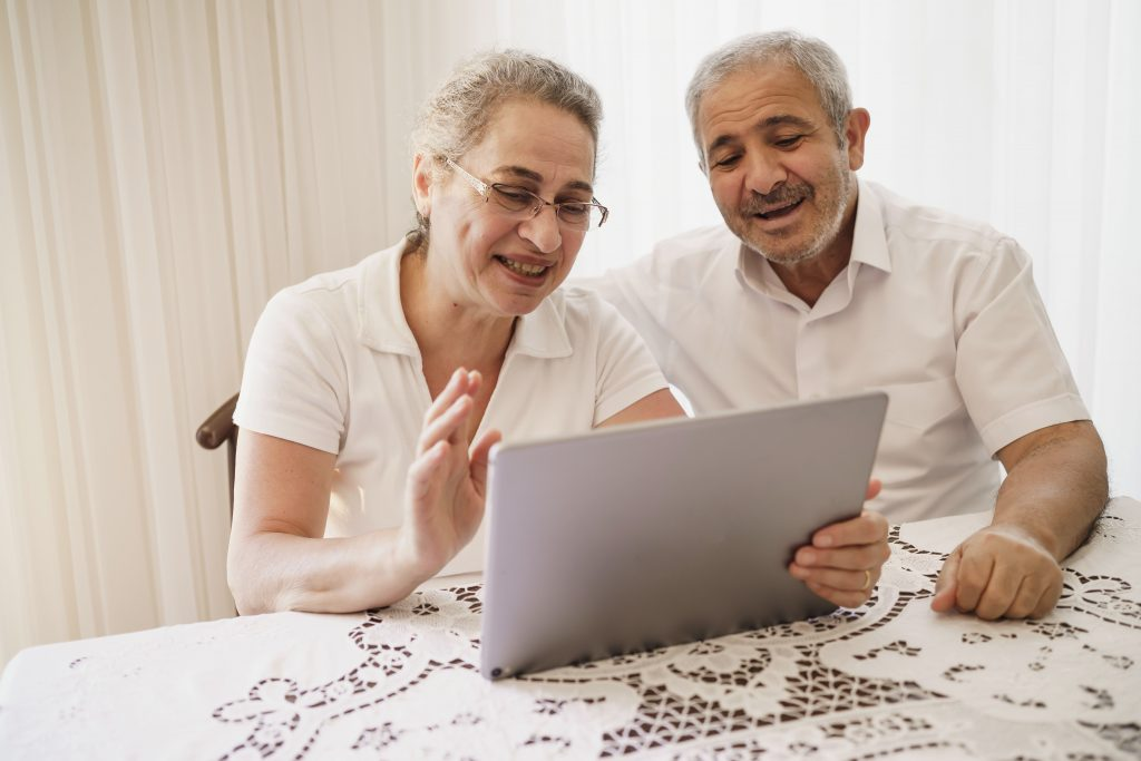 Two older caregivers attend Digital Essentials course by Senior Planet